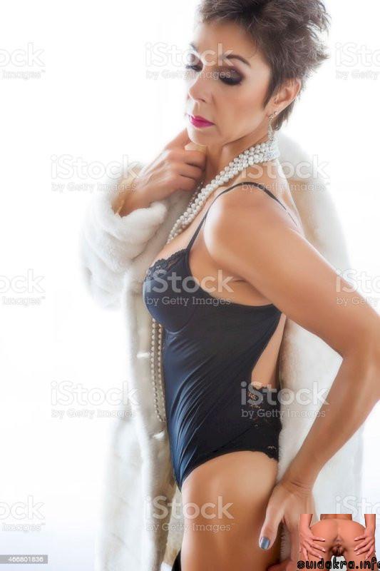 only photos of beautiful mature women corset woman posing